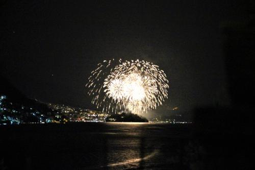 Fireworks over Sala Comacina at night on Lake Como