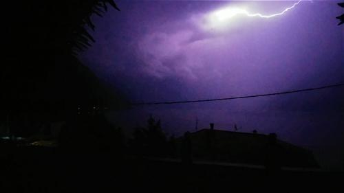 Lightning over Lake Como at night