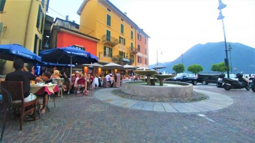 Piazza Roma Argegno with People