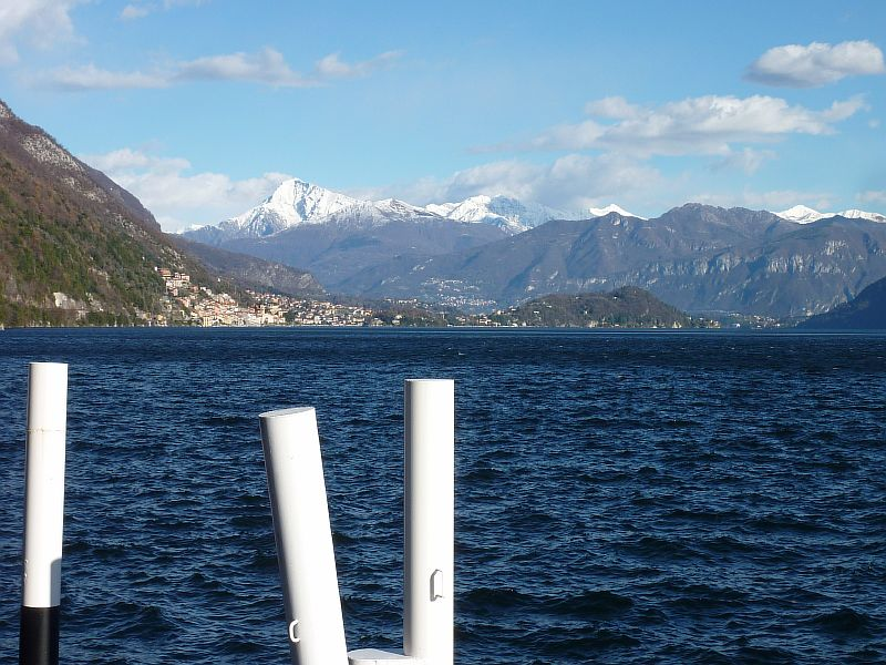 Looking across Lake Como to the snowy mountains