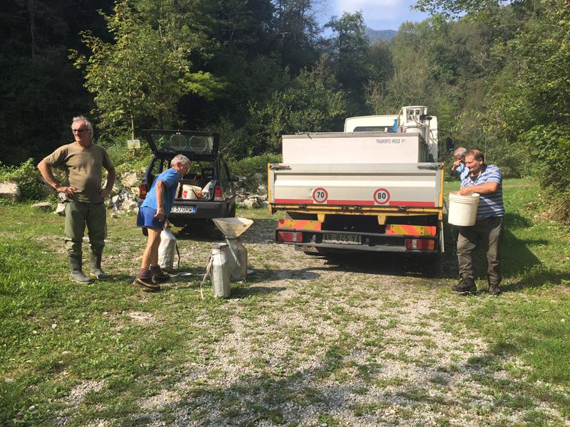 Dizzasco men unloading trout from truck